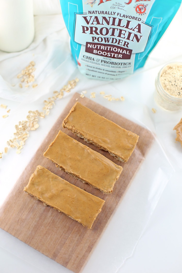 Vegan Vanilla Peanut Butter Snack Bars. Looking for a healthier snack recipe on-the-go? These Vegan Vanilla Peanut Butter Snack Bars are gluten-free and freezable! Click through for the full recipe! #FueledByBobs #sponsored | SeasonlyCreations.com