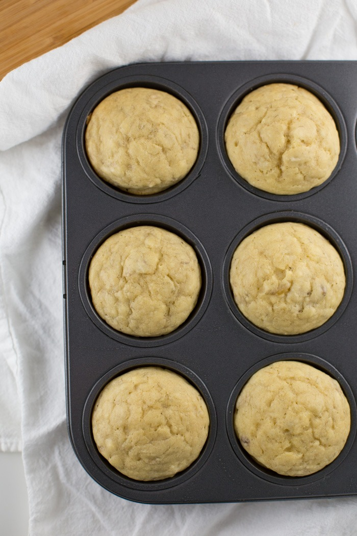 Healthy Orange Banana Muffins {Dairy Free, Low Sugar Recipe}. Whether you have a sweet tooth or need a quick breakfast option, this Healthy Orange Banana Muffin recipe will satisfy you! It's a low sugar and dairy-free recipe too! Click through for the full recipe and specialty ingredient list.